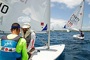 World Sailing Emerging Nations Program - Boca Chica Sailing Club, Santo Domingo 08/19/2017 - DAY 2 - Martin Manrique coach for Curazao talks to his sailor Darius Berenos