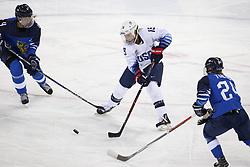 February 11, 2018 - Pyeongchang, KOREA - United States forward Gigi Marvin (19) battles Finland forward Noora Tulus (24) during women's hockey group A play during the Pyeongchang 2018 Olympic Winter Games at Kwandong Hockey Centre. The USA beat Finland 3-1. (Credit Image: © David McIntyre via ZUMA Wire)