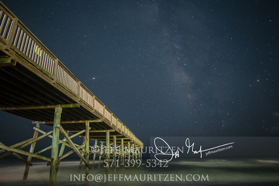 A wooden pier juts out into the Atlantic Ocean off Beaufort, North Carolina.