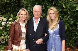 "LORD & LADY BELL with their daughter the HON.DAISY BELL at the Goodwood Festival of Speed on 9th July 2006.  Cartier sponsored the ""Style Et Luxe' for vintage cars on the final day of this annual event at Goodwood House, West Sussex and hosted a lunch.<br />