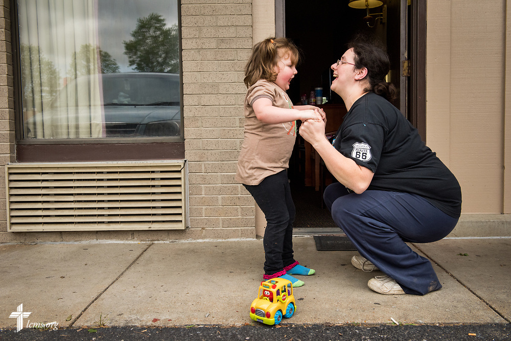 Amanda Prichard plays with her daughter Madalynn outside a motel on Monday, May 1, 2017, in Eureka, Mo. Local LCMS congregations and LCMS Disaster Response are assisting the Lutheran family who have been displaced due to rising flood waters. LCMS Communications/Erik M. Lunsford