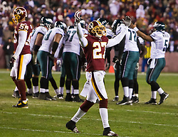 Washington Redskins cornerback Fred Smoot (27) prepares the crowd  during the final drive of the game.  The Washington Redskins defeated the Philadelphia Eagles 10-3 in an NFL football game held at Fedex Field in Landover, Maryland on Sunday, December 21, 2008.