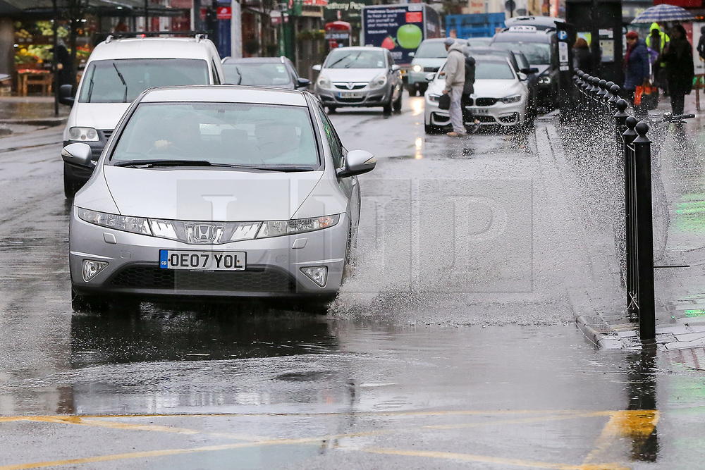© Licensed to London News Pictures. 12/03/2019. London, UK. A car splashes rain water as it travels through a flood on Green Lanes, Haringey in North London after a heavy downpour. Photo credit: Dinendra Haria/LNP