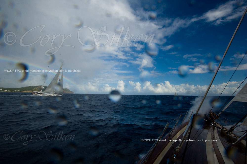 Racing onboard Tenacious, with Timoneer in the background, at the Superyacht Cup Regatta.