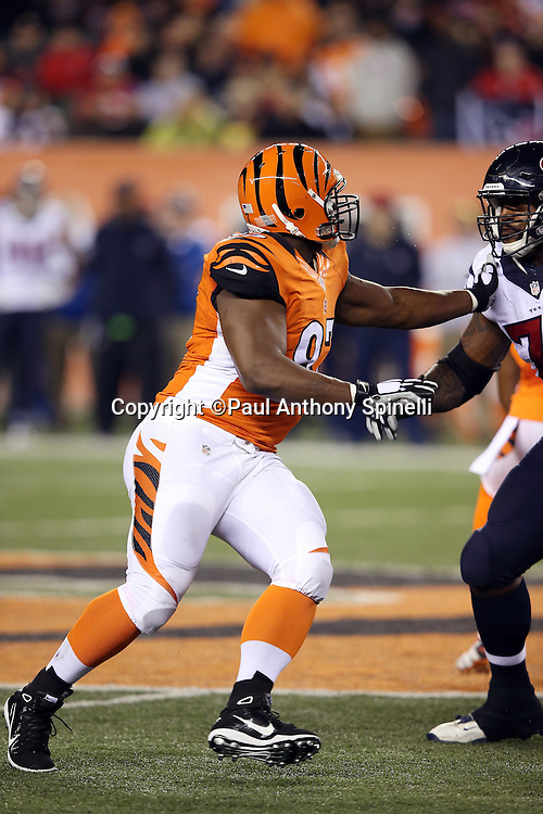 Cincinnati Bengals defensive tackle Geno Atkins (97) tries to work his way around a block by Houston Texans tackle Duane Brown (76) as he chases the action during the 2015 week 10 regular season NFL football game against the Houston Texans on Monday, Nov. 16, 2015 in Cincinnati. The Texans won the game 10-6. (©Paul Anthony Spinelli)