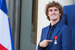 France's national team forward Antoine Griezmann leaves after receiving the Legion of Honour during a ceremony to award French 2018 football World Cup winners, on June 4, 2019, at the Elysee Palace in Paris. Photo by Raphael Lafargue/ABACAPRESS.COM