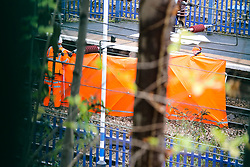 © Licensed to London News Pictures. 17/12/2019. London, UK. A tent covers the body of the person on the tracks hit by the train at Harringay overground station. <br /> A person has died after being hit by a train at Harringay overground station in north London. According to the British Transport Police, officers were called to the Harringay overground station shortly before 11.50 am of a casualty on the tracks. Paramedics attendance and the person was pronounced dead the the scene.  Photo credit: Dinendra Haria/LNP