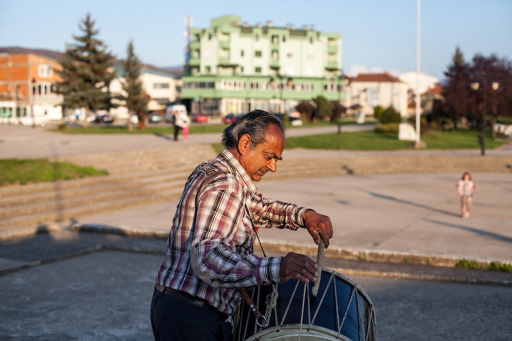 """Father Abdush preparing for a drum session on a stage in front of the """"House of Culture"""" in Delcevo, Macedonia. The Roma family - father and his 3 sons - are well know for their drum perfomances and also they build their drums themselves."""