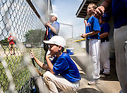 Meyers Dental players watch their quarterfinal game against Pappy's Grill. Teams throughout Licking County gathered at Mound City baseball fields Saturday to play in the Shrine Tournament quarter finals.