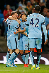 Frank Lampard of Manchester City celebrates with James Milner and Jesus Navas after scoring a goal to make it 1-0 - Photo mandatory by-line: Rogan Thomson/JMP - 07966 386802 - 24/08/2014 - SPORT - FOOTBALL - Manchester, England - Etihad Stadium - Manchester City v Sheffield Wednesday - Capital One Cup, Third Round.