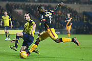 Bradford City midfielder Mark Marshall (7) shoots at goal attempting to be blocked by Oxford United defender Phil Edwards (16) 0-0 during the EFL Trophy match between Oxford United and Bradford City at the Kassam Stadium, Oxford, England on 31 January 2017. Photo by Alan Franklin.