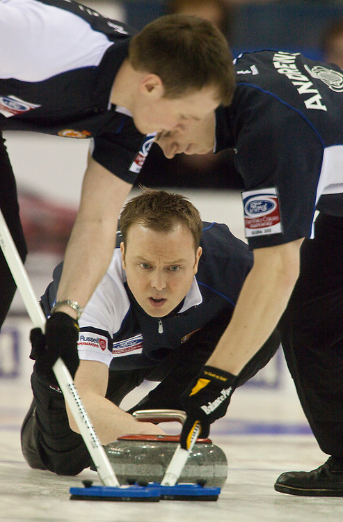 Scottish skip Tom Brewster delivers his shot during Scotland's 7-6 win over Norway in the semi-final at the Ford World Men's Curling Championships in Regina, Saskatchewan, April 9, 2011. The Scottish team will face Canada in the final Sunday.<br /> AFP PHOTO/Geoff Robins