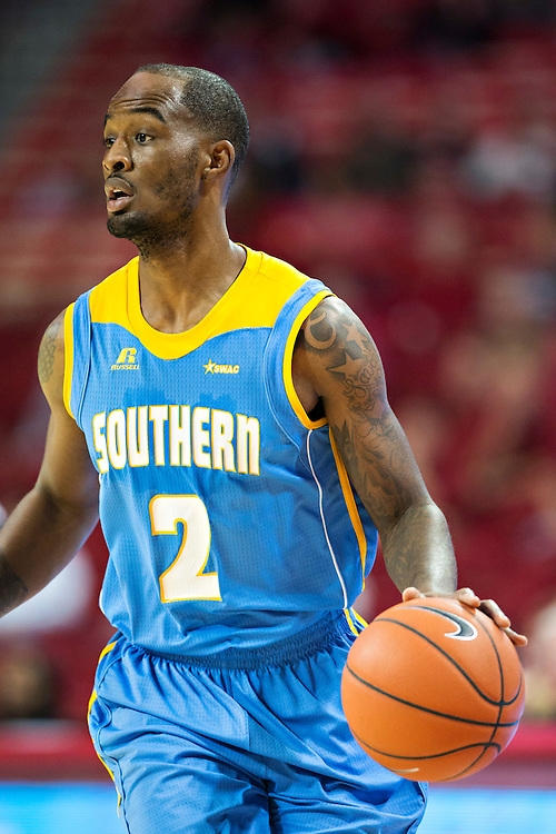 FAYETTEVILLE, AR - NOVEMBER 13:  Adrian Rodgers #2 of the Southern University Jaguars dribbles the ball down the court during a game against the Arkansas Razorbacks at Bud Walton Arena on November 13, 2015 in Fayetteville, Arkansas.  The Razorbacks defeated the Jaguars 86-68.  (Photo by Wesley Hitt/Getty Images) *** Local Caption *** Adrian Rodgers