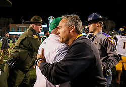 Nov 25, 2017; Huntington, WV, USA; Marshall Thundering Herd head coach Doc Holliday and Southern Miss Golden Eagles head coach Jay Hopson talk after the game at Joan C. Edwards Stadium. Mandatory Credit: Ben Queen-USA TODAY Sports