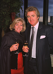 MR & MRS ROSS BENSON he is the journalist and she is Ingrid Seward editor of Majesty magazine, at a dinner in London on 27th April 1998.MHD 11