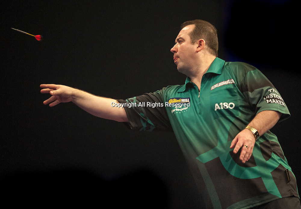 22.12.2014.  London, England.  William Hill PDC World Darts Championship.  Brendan Dolan (11) [NIR] in action during his game with Nolan Arendse [RSA].