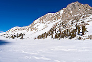 Backcountry skier crossing Loch Leven under Piute Pass, John Muir Wilderness, Sierra Nevada Mountains, California