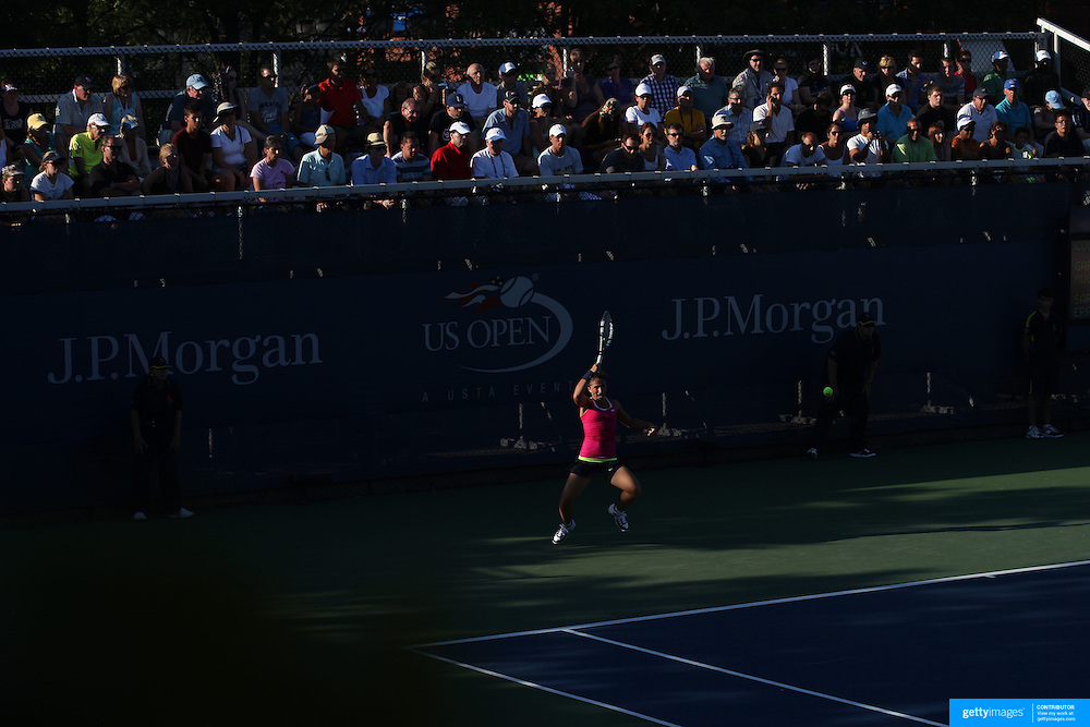 Sara Errani, Italy, in action in the late afternoon light against Garbine Muguruza, Spain, during the US Open Tennis Tournament, Flushing, New York. USA. 28th August 2012. Photo Tim Clayton
