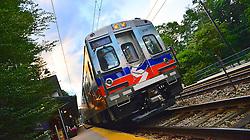 A brand new SEPTA Silverliner V leaves St. Martin station.
