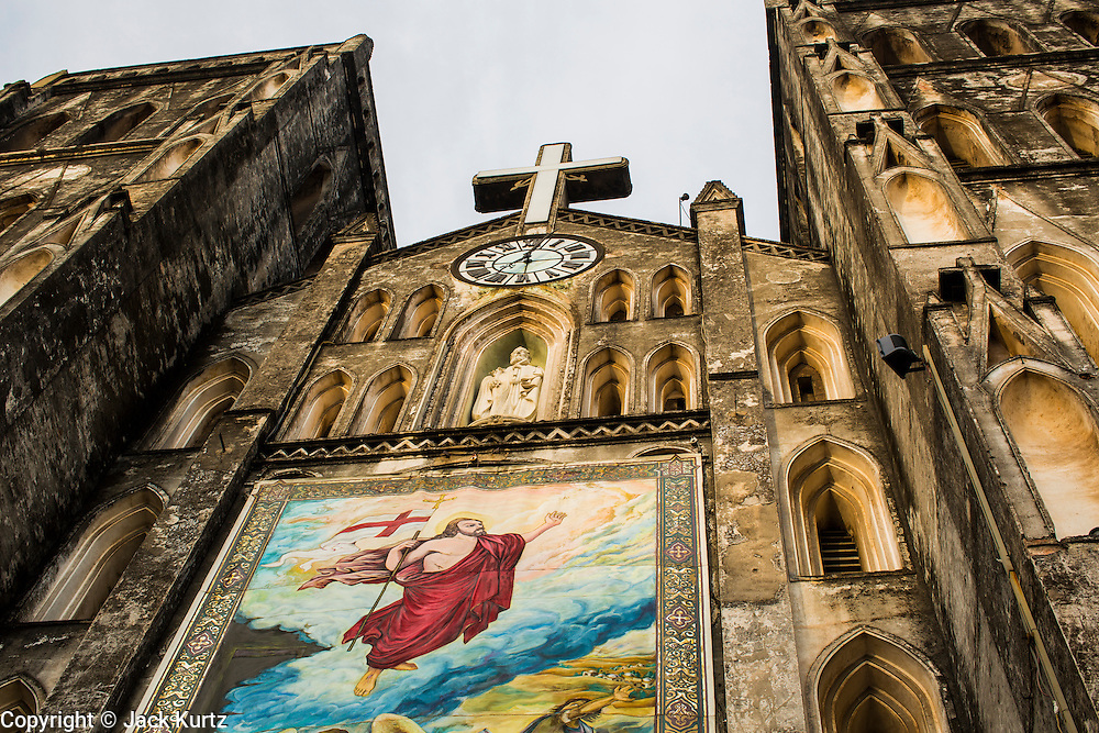 08 APRIL 2012 - HANOI, VIETNAM:     The front of St. Joseph Cathedral in Hanoi, Vietnam. St. Joseph Cathedral in Hanoi is the seat of the Roman Catholic Archdiocese of Hanoi and is one of the most important Catholic churches in Vietnam. It was built in 1886 and is especially crowded on religious holidays, like Easter. The church holds three Easter masses on Easter Sunday morning. There are more than 5.6 million Roman Catholics in Vietnam, nearly 7% of the population. Catholicism came to what is now Vietnam with Portuguese missionaries in the 16th Century, but it wasn't until the arrival of French missionaries and later colonial authorities that Catholicism became a part of Vietnamese religious life.   PHOTO BY JACK KURTZ