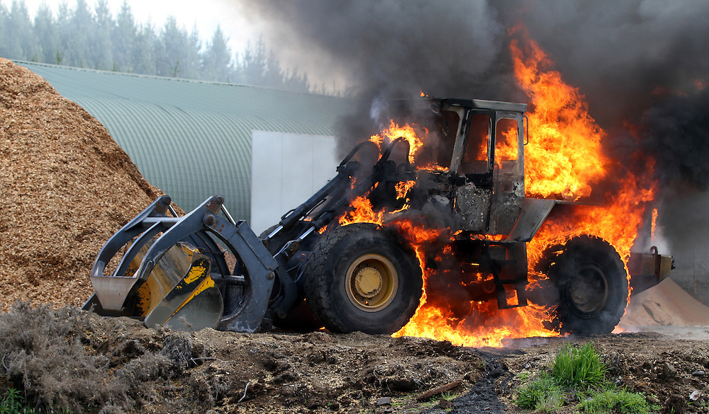 Fire crews attend a front end loader fire at the Waipa Mill near Rotorua, New Zealand, November 06, 2013. Credit:SNPA / Peter Graney.