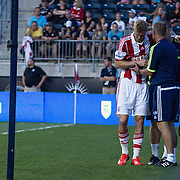 Stoke City F.C. Midfielder BREK SHEA (11) is help off the field by medical staff during a MLS regular season international friendly match against the Philadelphia Union Tuesday, July. 30, 2013 at PPL Park in Chester PA.