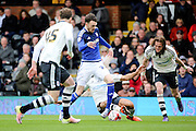 Cardiff City defender, Scott Malone (28) getting tackled by Fulham defender, Ashley (Jazz) Richards (02) during the Sky Bet Championship match between Fulham and Cardiff City at Craven Cottage, London, England on 9 April 2016. Photo by Matthew Redman.