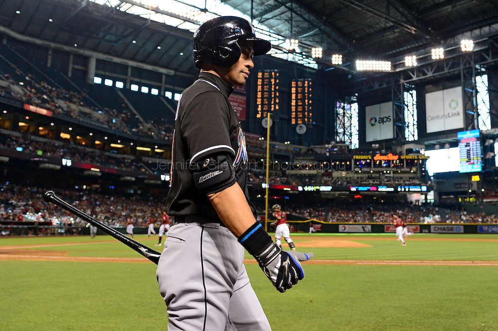 PHOENIX, AZ - JUNE 12:  Ichiro Suzuki #51 of the Miami Marlins walks back to dugout at the end of the eighth inning prior to a pinch hit against the Arizona Diamondbacks at Chase Field on June 12, 2016 in Phoenix, Arizona. The Arizona Diamondbacks won 6-0.  (Photo by Jennifer Stewart/Getty Images)
