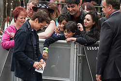 © licensed to London News Pictures. London, UK 10/06/2012. Tom Cruise signing a autograph to his fans at European premiere of Rock of Ages today in Leicester Square (10/06/12). Photo credit: Tolga Akmen/LNP