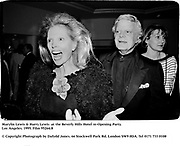 Marylin Lewis & Harry Lewis  at the Beverly Hills Hotel re-Opening Party. Los Angeles. 1995. Film 95264/8<br />