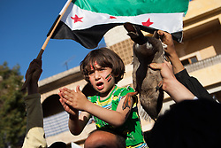 A Young girl singing songs against the regime of Bashar-Al-Assad with a duck in a demonstration at Termanin, north west Syria, tuesday, April 17, 2012...--Many other demonstrations through the country have been crackdown by the regime, braking one of the statement of the cease fired apply the 10th of April, Syria, April 17, 2012. Photo by Daniel Leal-Olivas / i-Images...Contact..Andrew Parsons: 00447545 311662.Stephen Lock: 00447860204379