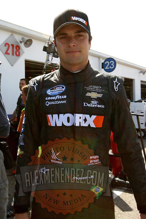 Nationwide driver Nelson Piquet Jr. is seen in the garage area, during a NASCAR Drive4COPD Nationwide Series practice session at Daytona International Speedway on Thursday, February 21, 2013 in Daytona Beach, Florida.  (AP Photo/Alex Menendez)