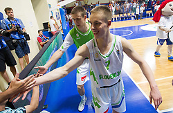 Klemen Prepelic of Slovenia and Jaka Brodnik of Slovenia celebrate after the basketball match between National teams of Slovenia and Spain in Qualifying Round of U20 Men European Championship Slovenia 2012, on July 18, 2012 in Domzale, Slovenia. Slovenia defeated Spain 70-63. (Photo by Vid Ponikvar / Sportida.com)
