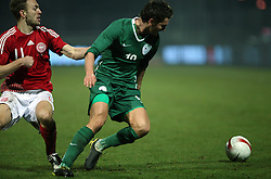 Andraz Kirm (19) and Dennis Rommedahl (11) of Denmark of Slovenia during the UEFA Friendly match between national teams of Slovenia and Denmark at the Stadium on February 6, 2008 in Nova Gorica, Slovenia. Slovenia lost 2:1. (Photo by Vid Ponikvar / Sportal Images).
