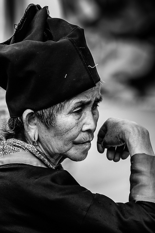 A portrait of a local lady at a market in Laos