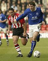 Photo. Aidan Ellis.<br /> Southampton v Everton.<br /> FA Barclaycard Premiership.<br /> 21/02/2004.<br /> Southampton's Paul Telfer and Everton's Kevin Kilbane