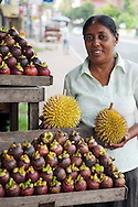 Kalutara, Sri Lanka, September 2011. A woman sells fruit at a stand next to the road.  Photo by Frits Meyst/Adventure4ever.com
