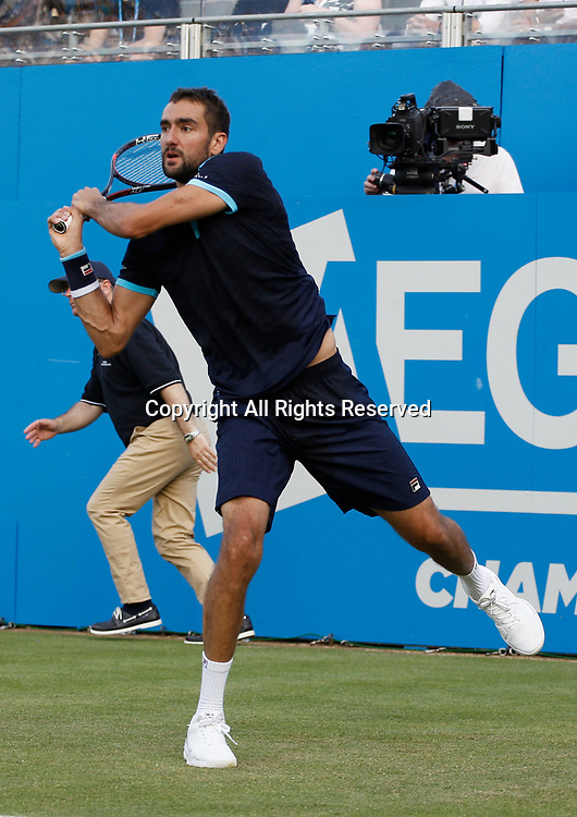 June 20th 2017, Queens Club, West Kensington, London; Aegon Tennis Championships, Day 2; Number four seed Marin Cilic (CRO) hits a backhand during his first round singles match against John Isner (USA); Cilic won in straight sets