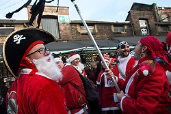 © Licensed to London News Pictures./14/2013. London, UK. Participants dressed in Father Christmas costumes gather for the annual Santacon celebration in Camdem.Photo credit : Peter Kollanyi/LNP