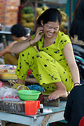 Rach Gia. Vinh Thanh Market along Cai Lon River. Laughing girl.