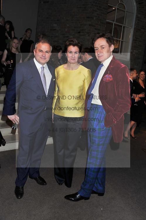 Left to right, JOHN RIGAS Chairman of Asprey, NICK & ALEX FOULKES at the Asprey BAFTA Party held at Asprey, 167 New Bond Street, London on 11th February 2012.