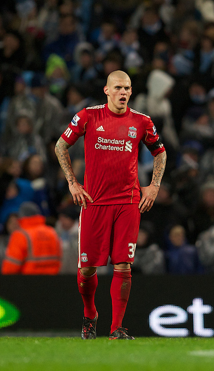 MANCHESTER, ENGLAND - Tuesday, January 3, 2012: Liverpool's Martin Skrtel looks dejected after gifting Manchester City's a penalty for their third goal during the Premiership match at the City of Manchester Stadium. (Pic by David Rawcliffe/Propaganda)