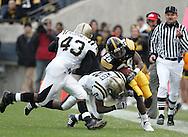 17 NOVEMBER 2007: Iowa wide receiver Paul Chaney (26) is hit by Western Michigan running back Brandon West (2) and Western Michigan wide receiver Tyler VanZandt (43) in Western Michigan's 28-19 win over Iowa at Kinnick Stadium in Iowa City, Iowa on November 17, 2007.