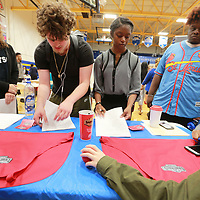Tupelo High School Students Maddie West, 17, from left, William Archibald, 18, Taylor Kelly, 18, and Braxton Foster, 18, take a few minutes and fill out job applications for Danver's at Monday's job fair at the high school.