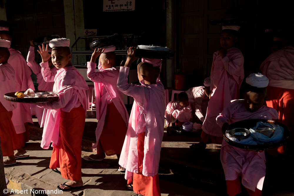 Nuns in the streets of the city, collecting Alms, Monywa, Myanmar