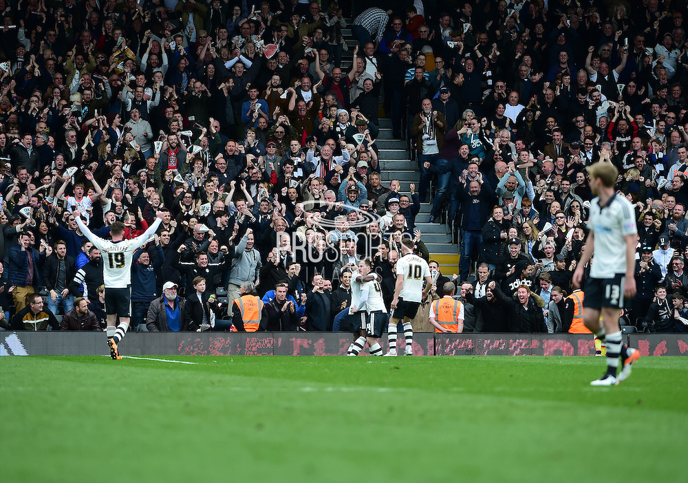 Fulham Forward Moussa Dembélé (25) celebrates his goal during the Sky Bet Championship match between Fulham and Milton Keynes Dons at Craven Cottage, London, England on 2 April 2016. Photo by Jon Bromley.