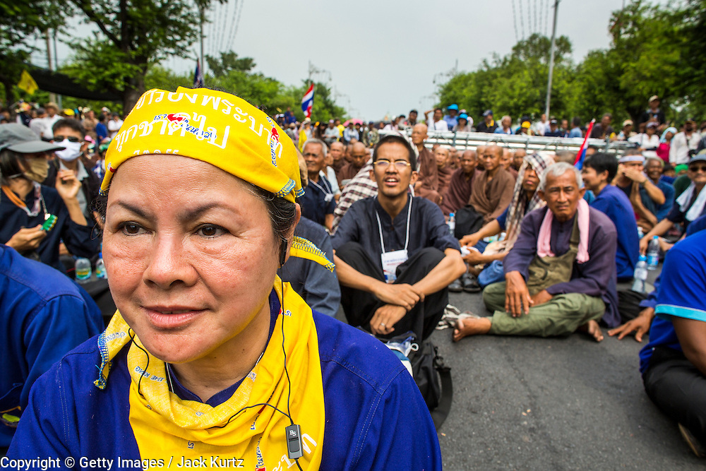 24 NOVEMBER 2012 - BANGKOK, THAILAND: A woman protester with a yellow bandana during a large anti government, pro-monarchy, protest  on November 24, 2012 in Bangkok, Thailand. Yellow is the color of the Thai monarchy and is worn as an expression of support for the monarchy. The Siam Pitak group, which sponsored the protest, cited alleged government corruption and anti-monarchist elements within the ruling party as grounds for the protest. Police used tear gas and baton charges againt protesters.       PHOTO BY JACK KURTZ