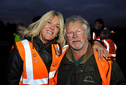 © Licensed to London News Pictures. 10/10/2013.  Corse Lawn, Gloucestershire, UK.  Billie Oddie poses with Wounded Badger Patrol member Tracy Warren from Hitchin in Hertfordshire.  Bill Oddie visited the Wounded Badger Patrol in Gloucestershire, where patrollers go out looking for dead or wounded badgers on public footpaths and roads.  The Government has licensed a pilot badger cull in parts of Somerset and Gloucestershire as part of efforts to reduce bovine tuberculosis in cows on farms and is considering extending the cull as the targets for culled badgers have not been met.  10 October 2013.<br /> Photo credit : Simon Chapman/LNP