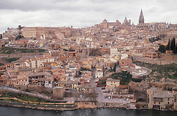General view of Toledo; showing the Cathedral and rooftops,