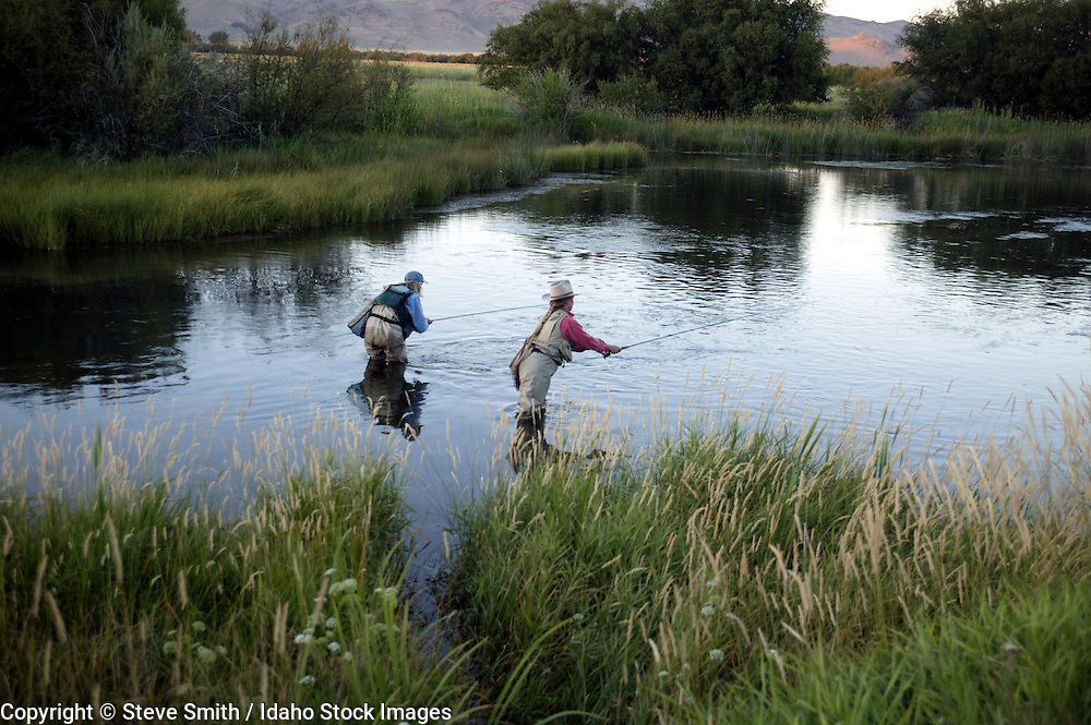 Idaho, Silver Creek.  Women fly fishing in the evening near Ketchum and Sun Valley.
